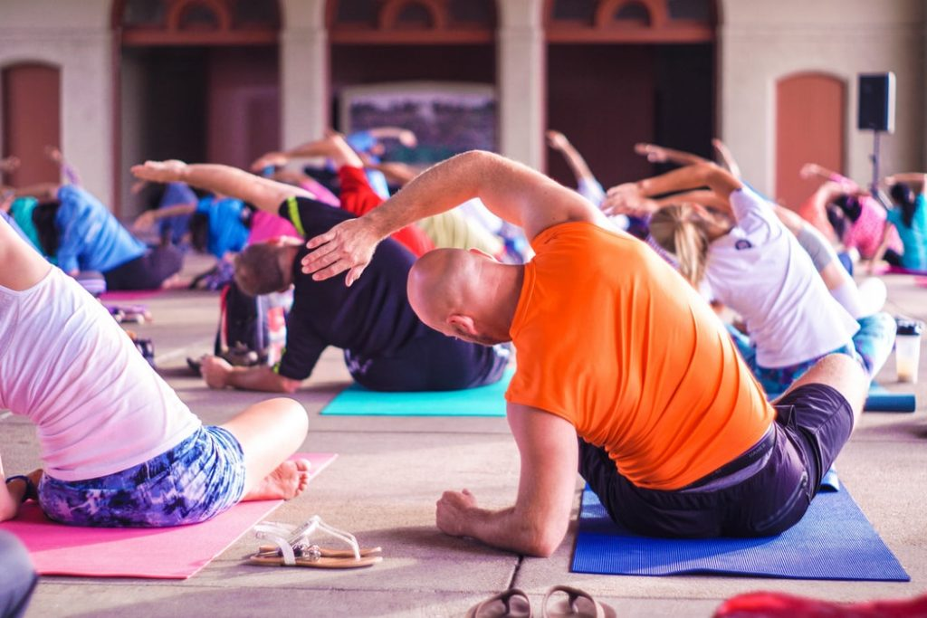 a class participating in yoga