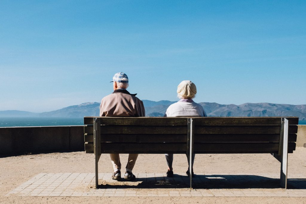Elderly couple sitting on bench