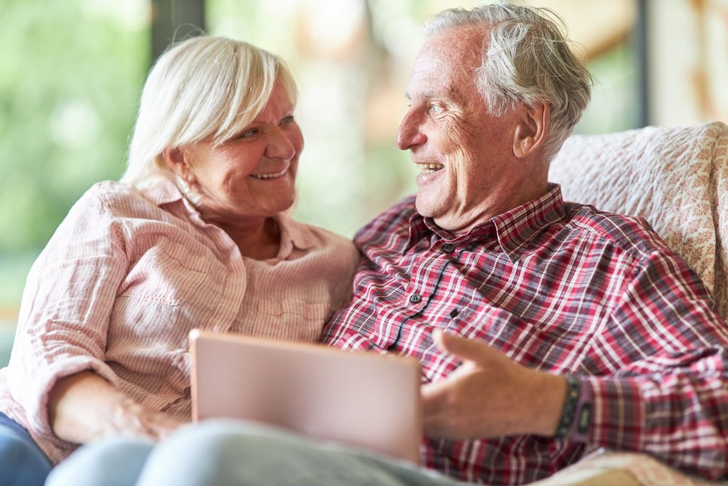 Retired Senior Couple Using Tablet